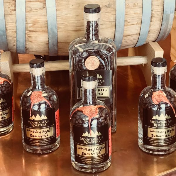 Specialty Blend Air Roasted Coffee Whiskey Aged Sumatra in a bottle